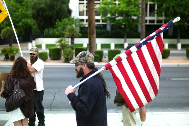 Joe Carlisle of Pennsylvania protests outside of the Lloyd George Federal Building ahead of an arraignment for Ammon and Ryan Bundy, among others, in Las Vegas on Friday, April 15, 2016. The arrai ...