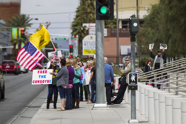 People protest outside of the Lloyd George Federal Building ahead of an arraignment for Ammon and Ryan Bundy, among others, in Las Vegas on Friday, April 15, 2016. The arraignment is for charges s ...