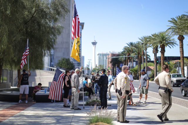 Police and protesters gather outside the Lloyd George U.S. Courthouse in Las Vegas on Friday, April 22, 2016. All 19 defendants charged in the 2014 Bunkerville standoff were in court for a hearing ...