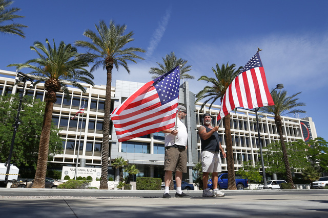 Hold flags outside the Lloyd George U.S. Courthouse in Las Vegas on Friday, April 22, 2016. All 19 defendants charged in the 2014 Bunkerville standoff were in court for a hearing. Brett Le Blanc/L ...