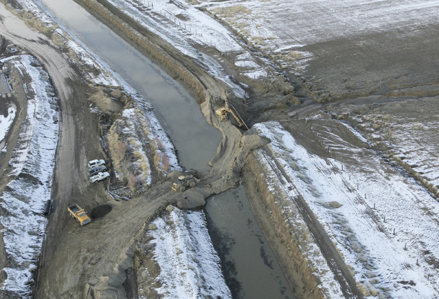 A levee that broke, flooding homes and forcing evacuations in 2008, is shown in the process of being repaired in Fernley. (Brad Horn/The Associated Press)