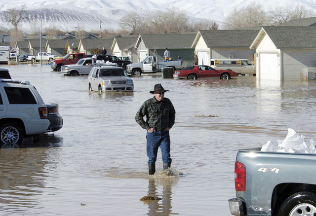 A man walks amid the flooded area in Fernley in 2008. (Tim Dunn/Reno-Gazette Journal via AP)