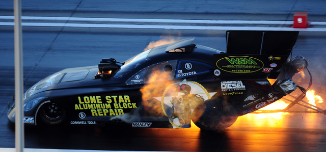 The Funny Car driven by Terry Haddock suffers an engine explosion during the final round of qualifying for the DENSO Spark Plugs NHRA Nationals at The Strip at Las Vegas Motor Speedway in Las Vega ...