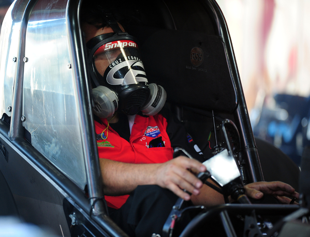 NHRA Funny Car driver Cruz Pedregon tests the engine in the paddock before the final round of qualifying for the DENSO Spark Plugs NHRA Nationals at The Strip at Las Vegas Motor Speedway in Las Ve ...