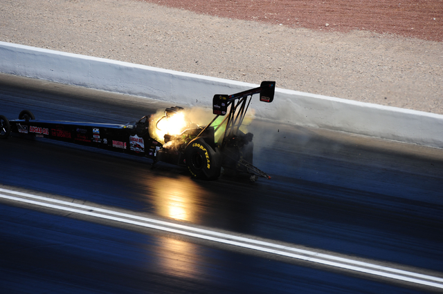 The Top Fuel dragster driven by Scott Palmer suffers an engine explosion during the final round of qualifying for the DENSO Spark Plugs NHRA Nationals at The Strip at Las Vegas Motor Speedway in L ...