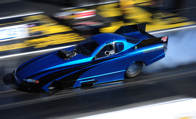 NHRA Top Alcohol Funny Car driver Mike Doushgounian does a burnout during qualifying for the DENSO Spark Plugs NHRA Nationals at The Strip at Las Vegas Motor Speedway in Las Vegas Saturday, April  ...