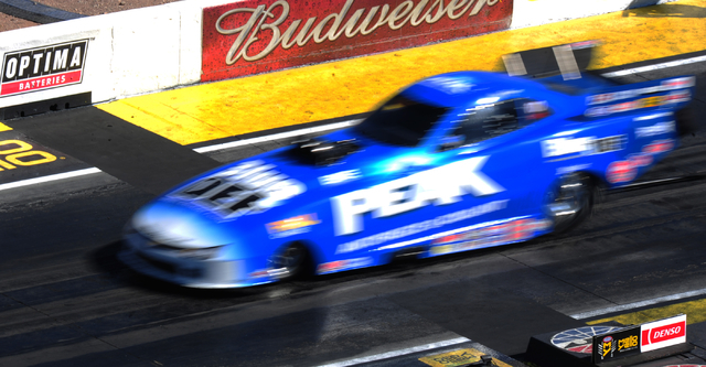 NHRA Top Alcohol Funny Car driver Jay Payne launches across the starting line during qualifying for the DENSO Spark Plugs NHRA Nationals at The Strip at Las Vegas Motor Speedway in Las Vegas Satur ...