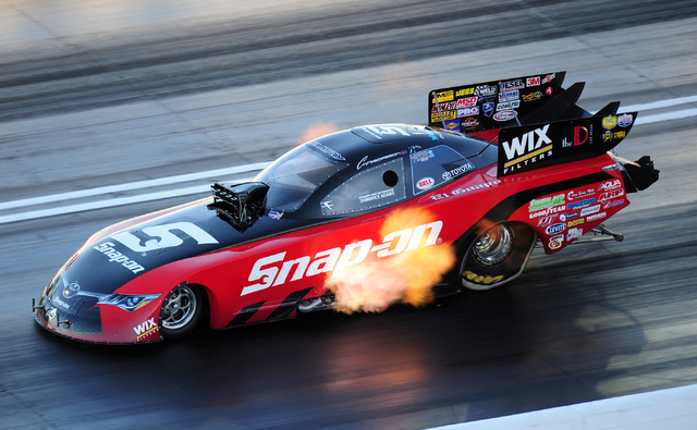 NHRA Funny Car driver Cruz Pedregon lays down a pass of 301.20 MPH at 3.982 elapsed time during the final round of qualifying for the DENSO Spark Plugs NHRA Nationals at The Strip at Las Vegas Mot ...
