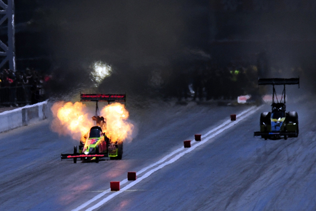 The engine onboard the Top Fuel dragster driven by J.R. Todd explodes during the second round of eliminations of the DENSO Spark Plugs NHRA Nationals at The Strip at Las Vegas Motor Speedway in La ...