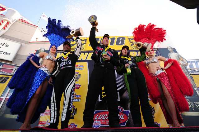NHRA Top Fuel driver Antron Brown, left, Pro Stock driver Jason Line, center, and Funny Car driver Alexis Dejoria celebrate winng the DENSO Spark Plugs NHRA Nationals in their respective classes a ...