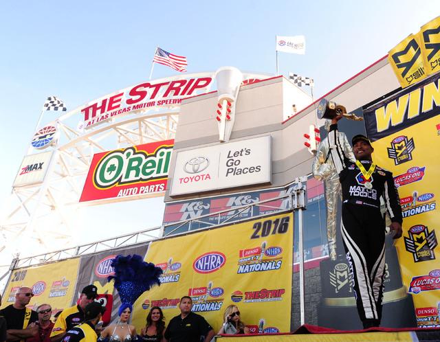 NHRA Top Fuel driver Antron Brown celebrates winning the DENSO Spark Plugs NHRA Nationals at The Strip at Las Vegas Motor Speedway in Las Vegas Sunday, April 3, 2016. (Josh Holmberg/Las Vegas Revi ...