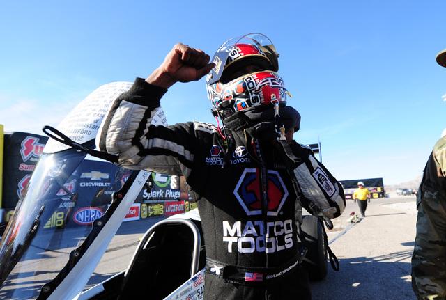 NHRA Top Fuel driver Antron Brown celebrates winning the DENSO Spark Plugs NHRA Nationals at The Strip at Las Vegas Motor Speedway in Las Vegas Sunday, April 3, 2016.  (Josh Holmberg/Las Vegas Rev ...
