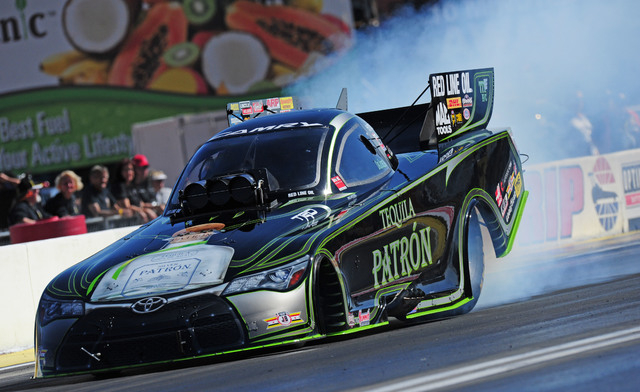 NHRA Funny Car driver Alexis Dejoria performs a burnout procedure in the third round of eliminations of the DENSO Spark Plugs NHRA Nationals at The Strip at Las Vegas Motor Speedway in Las Vegas S ...