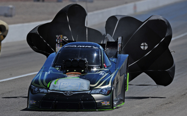 NHRA Funny Car driver Alexis Dejoria deploys her parachutes in the second round of eliminations of the DENSO Spark Plugs NHRA Nationals at The Strip at Las Vegas Motor Speedway in Las Vegas Sunday ...