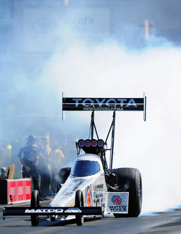 NHRA Top Fuel driver Antron Brown performs a burnout procedure in the third round of eliminations of the DENSO Spark Plugs NHRA Nationals at The Strip at Las Vegas Motor Speedway in Las Vegas Sund ...