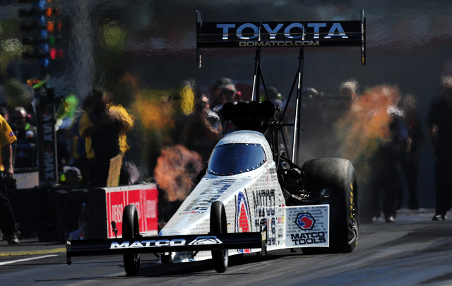 NHRA Top Fuel driver Antron Brown launches off the starting line in the third round of eliminations of the DENSO Spark Plugs NHRA Nationals at The Strip at Las Vegas Motor Speedway in Las Vegas Su ...