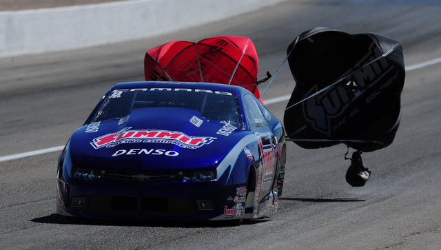 NHRA Pro Stock driver Jason Line deploys his parachutes in the second round of the DENSO Spark Plugs NHRA Nationals at The Strip at Las Vegas Motor Speedway in Las Vegas Sunday, April 3, 2016. Jos ...