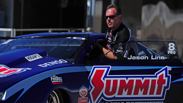 NHRA Pro Stock driver Jason Line steers his car back to the pits in the second round of the DENSO Spark Plugs NHRA Nationals at The Strip at Las Vegas Motor Speedway in Las Vegas Sunday, April 3,  ...