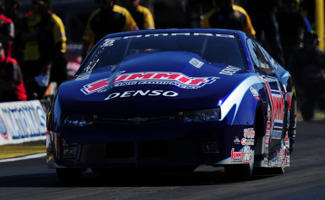NHRA Pro Stock driver Jason Line launches off the starting line in the third round of the DENSO Spark Plugs NHRA Nationals at The Strip at Las Vegas Motor Speedway in Las Vegas Sunday, April 3, 20 ...
