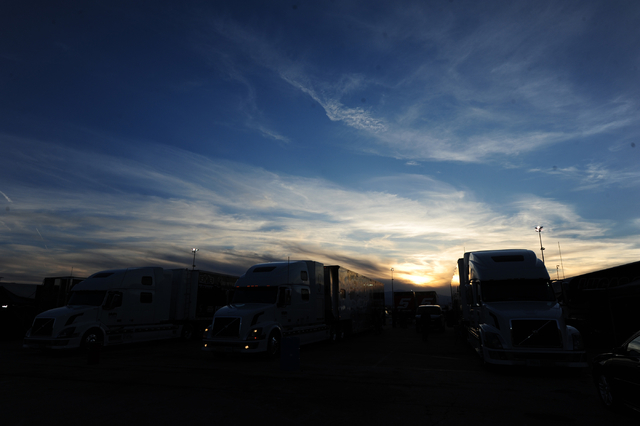 Race dar haulers are seen in the paddock as the sun sets after the conclusion of the DENSO Spark Plugs NHRA Nationals at The Strip at Las Vegas Motor Speedway in Las Vegas Sunday, April 3, 2016. J ...