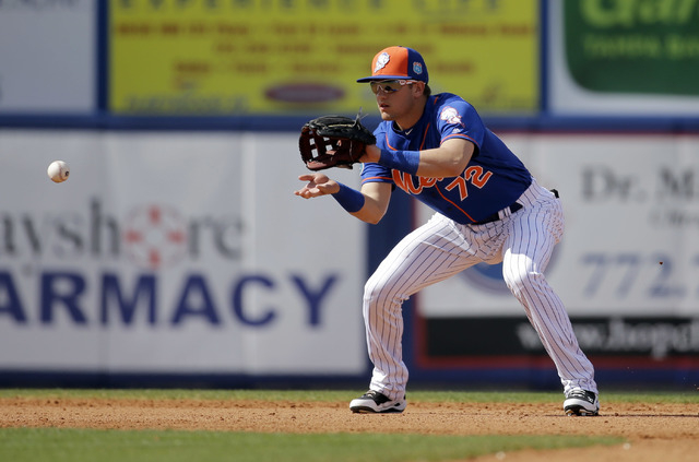New York Mets shortstop Gavin Cecchini handles a grounder hit by St. Louis Cardinals' Brandon Moss during the sixth inning of an exhibition spring training baseball game Thursday, March 10, 2016,  ...