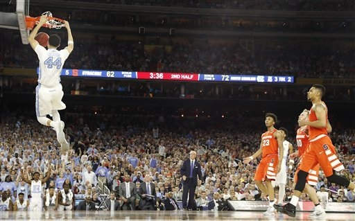 North Carolina forward Justin Jackson (44) dunks the ball on Syracuse during the second half of the NCAA Final Four tournament college basketball semifinal game Saturday, April 2, 2016, in Houston ...