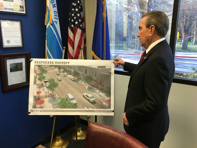 Carson City Mayor Bob Crowell looks at an artist's rendering of a portion of the Carson Downtown Streetscape Improvement Project in his office on Thursday, March 24, 2016. Sean Whaley/Las Vegas Re ...