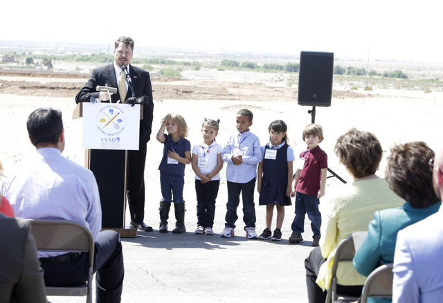 Pat Skorkowsky, CCSD Superintendent, flanked by CT Sewell Elementary School students Teresa, left, King, Kalia, Gloria, and Charlie, speaks Thursday, April 14, 2016 during the groundbreaking cerem ...