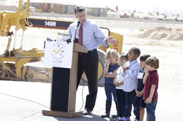 Nevada Gov. Brian Sandoval, flanked by CT Sewell Elementary School students Teresa, left, King, Kalia, Gloria, and Charlie, speaks Thursday, April 14, 2016 during the groundbreaking ceremony at th ...