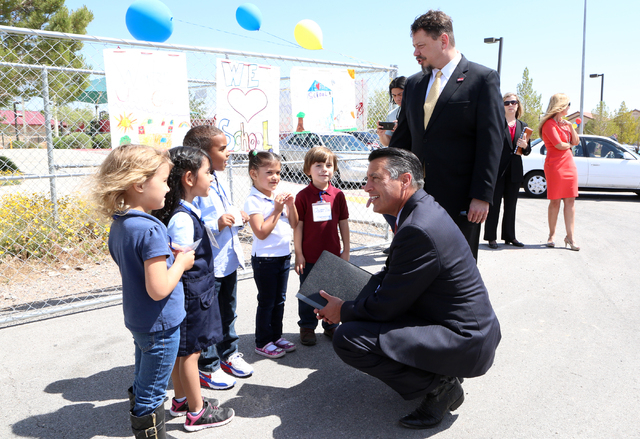 Nevada Gov. Brian Sandoval and Pat Skorkowsky, CCSD Superintendent, are greeted by CT Sewell Elementary School students Teresa, left, Gloria, King, Kalia, and Charlie, Thursday, April 14, 2016 as  ...