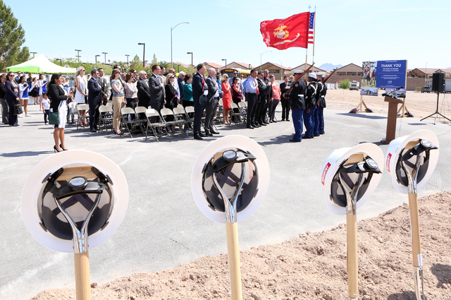 State officials, including Nevada Gov. Brian Sandoval stand during the Pledge of Allegiance Thursday, April 14, 2016 during the groundbreaking ceremony at the site of a new elementary school near  ...
