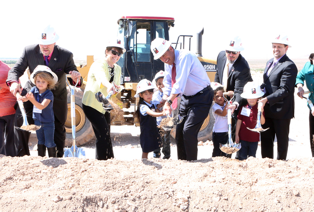 Nevada Gov. Brian Sandoval, center, and Pat Skorkowsky, CCSD Superintendent, second right,, Stete Sen. Mark Manendo, right, and CT Sewell Elementary School students turn shovels Thursday, April 14 ...