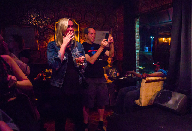 People watch as karaoke jockey Doug Price, not pictured, performs at Champagne's in Las Vegas on Friday, April 22, 2016. Chase Stevens/Las Vegas Review-Journal Follow @csstevensphoto