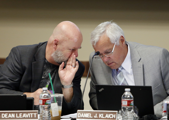 Chancellor Dan Klaich, right, listens to Regent James Leavitt during a Board of Regents meeting on Friday, April 23, 2015, at the Nevada System of Higher Education boardroom. (Bizuayehu Tesfaye/La ...