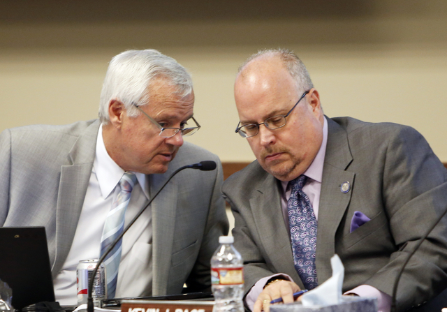 Chancellor Dan Klaich, left, talks to Chairman Kevin Page during a Board of Regents meeting on Friday, April 23, 2015, at the Nevada System of Higher Education boardroom. (Bizuayehu Tesfaye/Las Ve ...