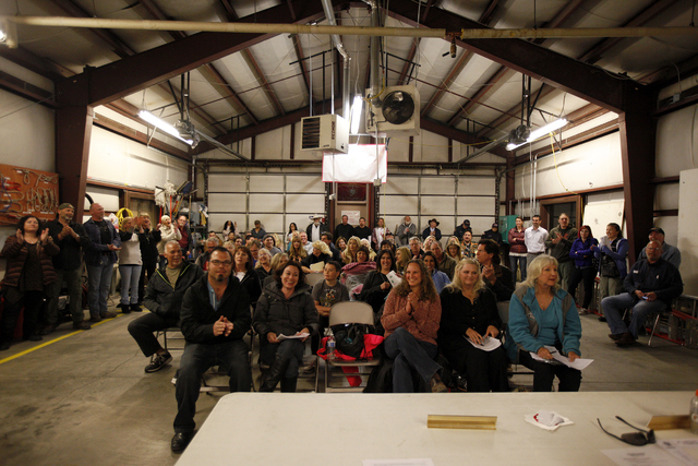 The audience applauses after no one came forward to support a change to Title 30 during A packed Town Hall meeting at the Volunteer Fire Department building in Mount Charleston Thursday, March 31, ...