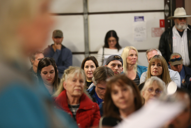 Brenda Talley discusses the petition she authored against changing Title 30 to a packed Town Hall meeting at the Volunteer Fire Department building in Mount Charleston Thursday, March 31, 2016. Ra ...