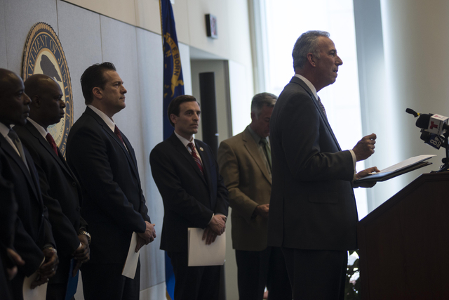 Steve Wolfson, Clark County District Attorney, speaks during a news conference on Thursday, Feb. 12, 2015, at the Lloyd D. George Federal Courthouse in Las Vegas to discuss ongoing efforts to prev ...