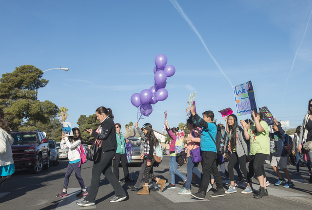 Students, administrators and parents walk Wednesday, March 6, 2016, to honor  Maxine Lopez, 12, who recently died after being taken to the hospital with pain in her neck and thighs. (Jacob Kepler/ ...