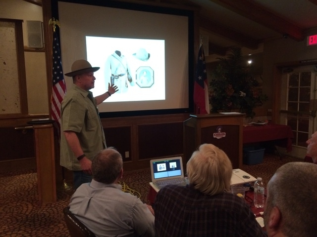 Charles Smith, a member of the Las Vegas Civil War Round Table, gives a presentation March 22 during a show and tell portion of the group's meeting. The hat he wears is one he had made, a replic ...