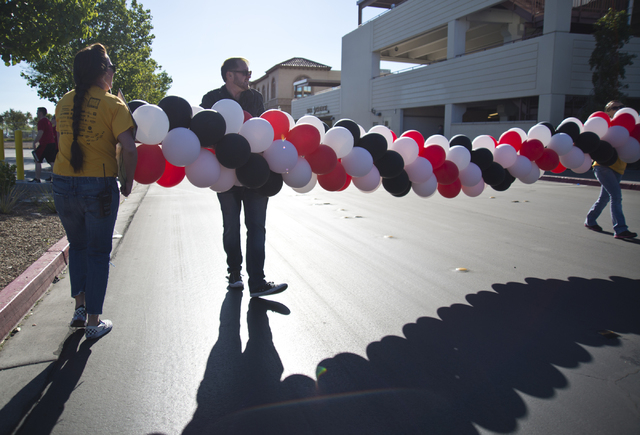 Volunteers help to move a balloon arch during the 26th annual Aid for AIDS of Nevada (AFAN) AIDS Walk Las Vegas at Town Square in Las Vegas on Sunday, April 17, 2016. (Daniel Clark/Las Vegas Revie ...