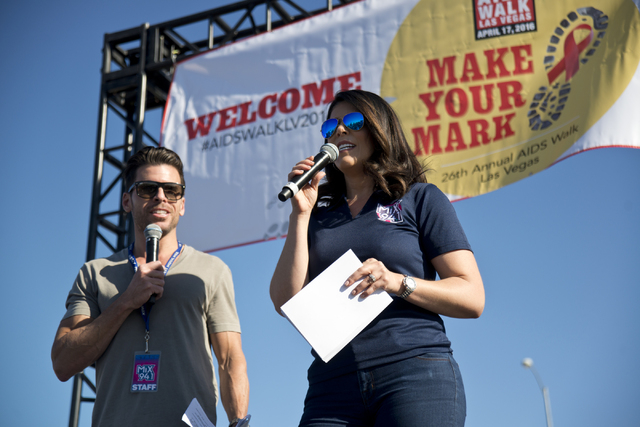 Mercedes Martinez, right, and J.C. Fernandez of KXMB-FM, Mix 94.1 host opening ceremonies during the 26th annual Aid for AIDS of Nevada (AFAN) AIDS Walk Las Vegas at Town Square in Las Vegas on Su ...