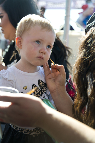 Caroline Hollowood has her face painted during the 26th annual Aid for AIDS of Nevada (AFAN) AIDS Walk Las Vegas at Town Square in Las Vegas on Sunday, April 17, 2016. (Daniel Clark/Las Vegas Revi ...