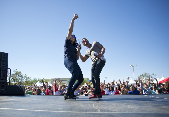 Mercedes Martinez, left, and J.C. Fernandez of KXMB-FM, Mix 94.1take a selfie with the crowd during the 26th annual Aid for AIDS of Nevada (AFAN) AIDS Walk Las Vegas at Town Square in Las Vegas on ...