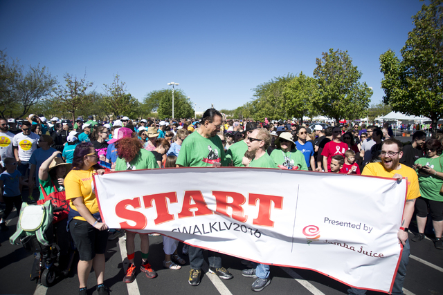 Carrot top, from left, Penn Jillette, and Teller stand at the starting line for the 26th annual Aid for AIDS of Nevada (AFAN) AIDS Walk Las Vegas at Town Square in Las Vegas on Sunday, April 17, 2 ...