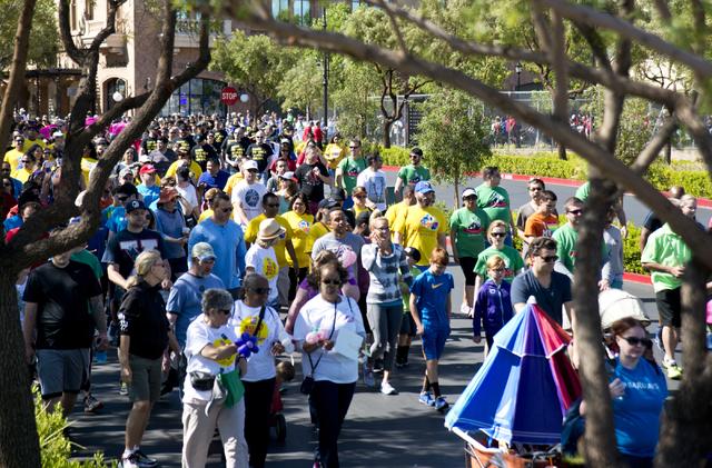 Participants walk during the 26th annual Aid for AIDS of Nevada (AFAN) AIDS Walk Las Vegas at Town Square in Las Vegas on Sunday, April 17, 2016. (Daniel Clark/Las Vegas Review-Journal) Follow @Da ...