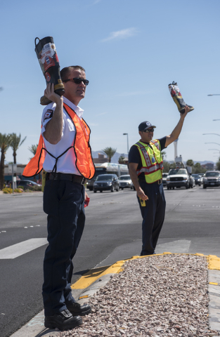"EMS Field Coordinator Scott Phillips, left, and Fire Engineer Kurt Bacca, greets motorists to collect donations for the annual ""Fill the Boot"" drive that benefits the Muscular Dy ..."