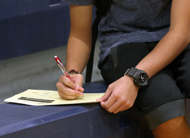A student works on a form during the Integrating Career Academies by Networking Business and Education program at Basic High School Wednesday, April 20, 2016, in Henderson. Students visited booths ...