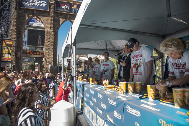 The crowd gets ready for the start of the Nathan's Famous Hot Dog Eating Contest qualifier from the Brooklyn Bridge at New York-New York hotel-casino in Las Vegas on Saturday, April 23, 2016. (Mar ...