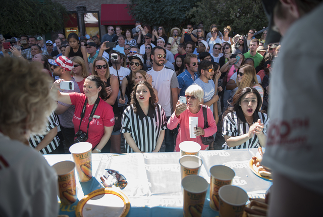 The crowd cheers on the competitors during the Nathan's Famous Hot Dog Eating Contest qualifier at the Brooklyn Bridge at New York-New York hotel-casino in Las Vegas on Saturday, April 23, 2016. ( ...